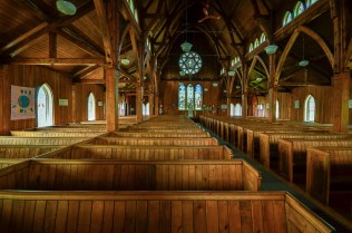 Inside St Paul's Anglican Church wooden pews.