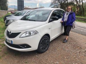 Anna beside Rental Lancia.